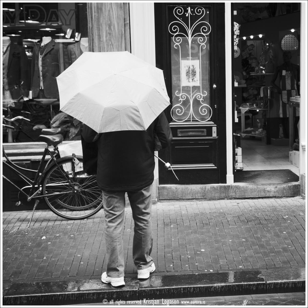 Man with umbrella - Amsterdam