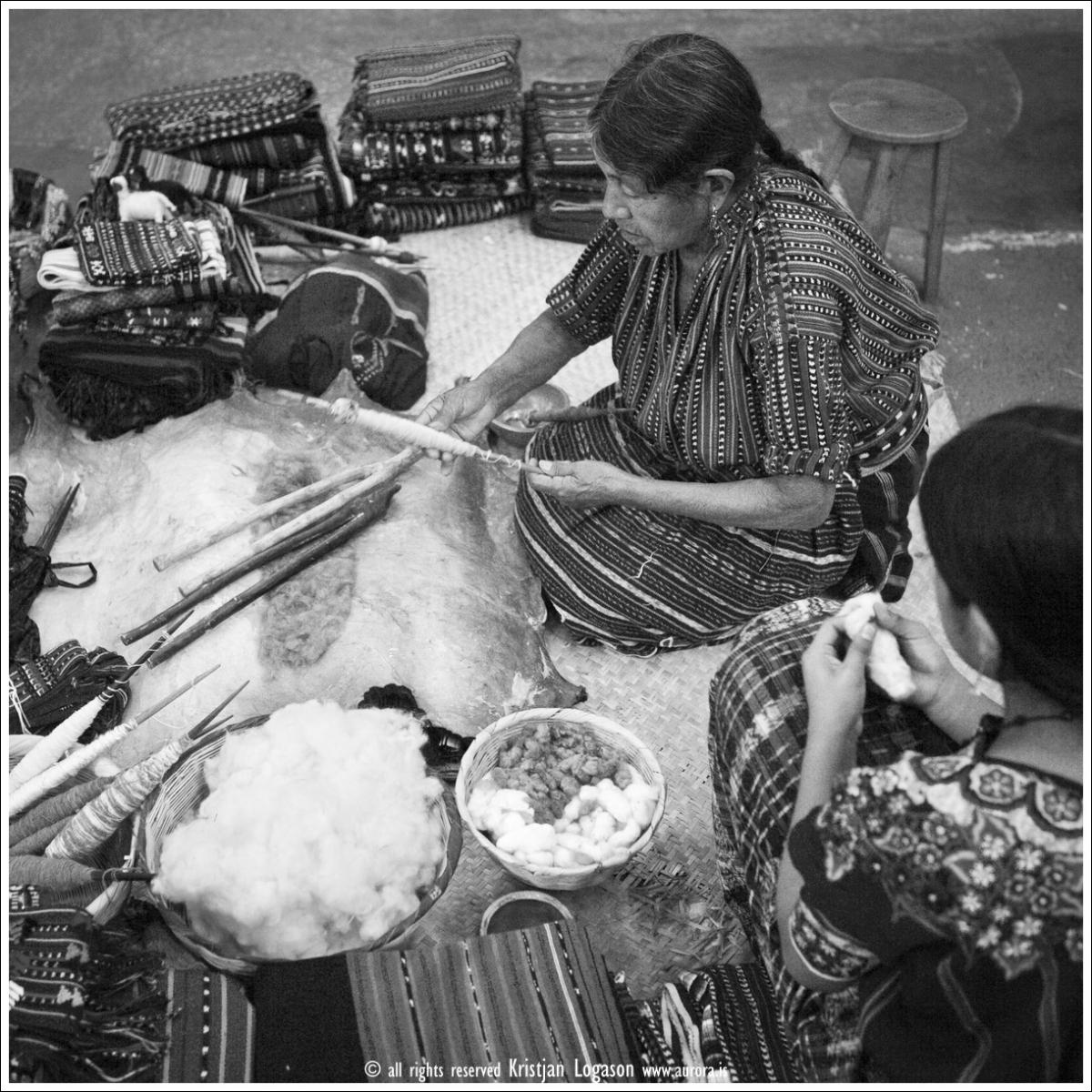 Woman spinning thread in an art shop in Antigua Guatemala