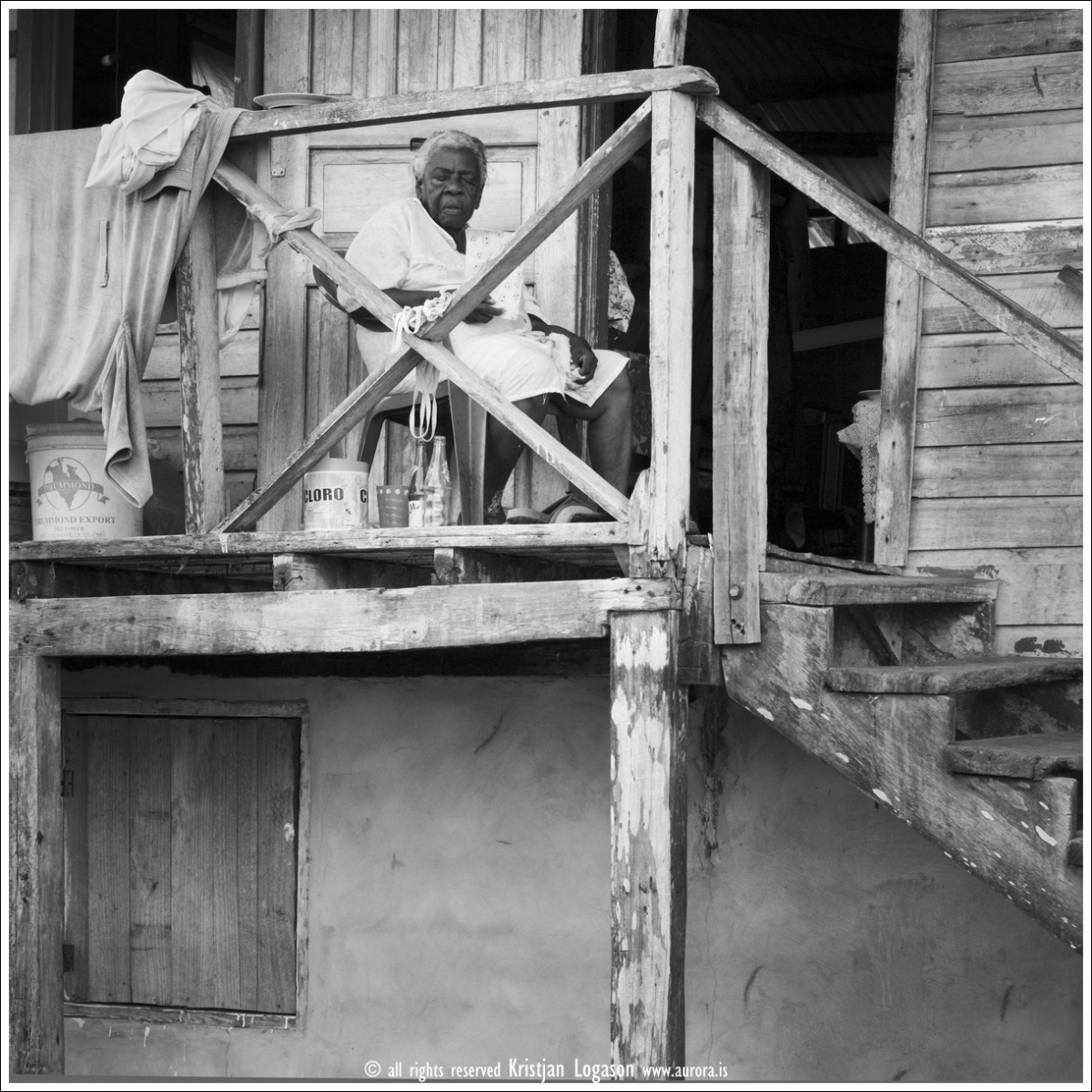 Old woman sleeping in a chair on the front porch, island of Bastimento, Bocas del Toro, Panama