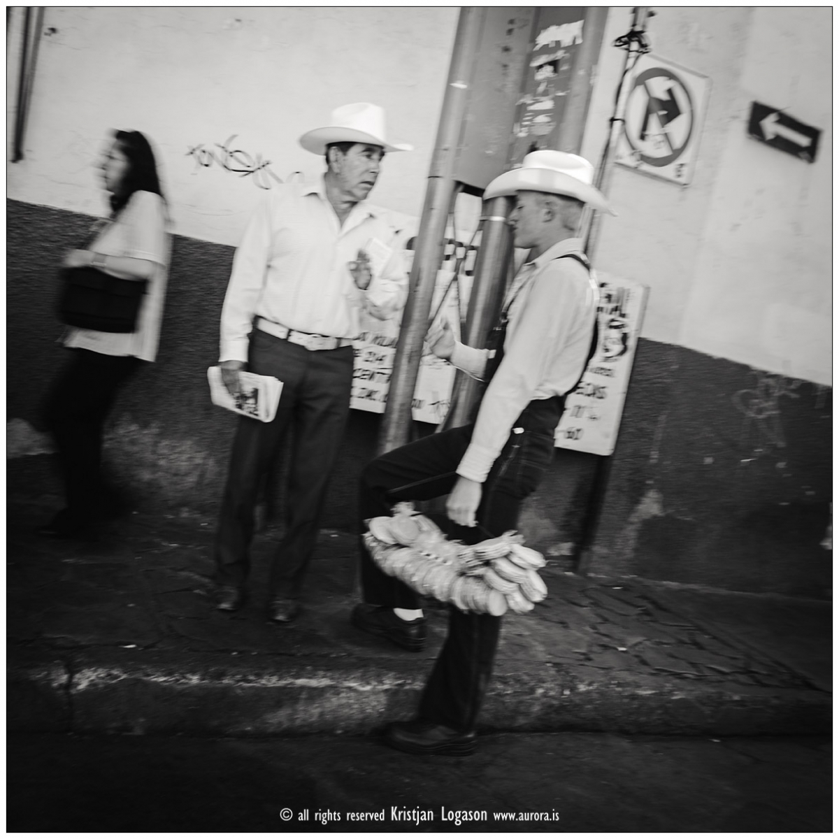 Two men with hats and bunch of bread in a street of Zacatecas city, Mexico