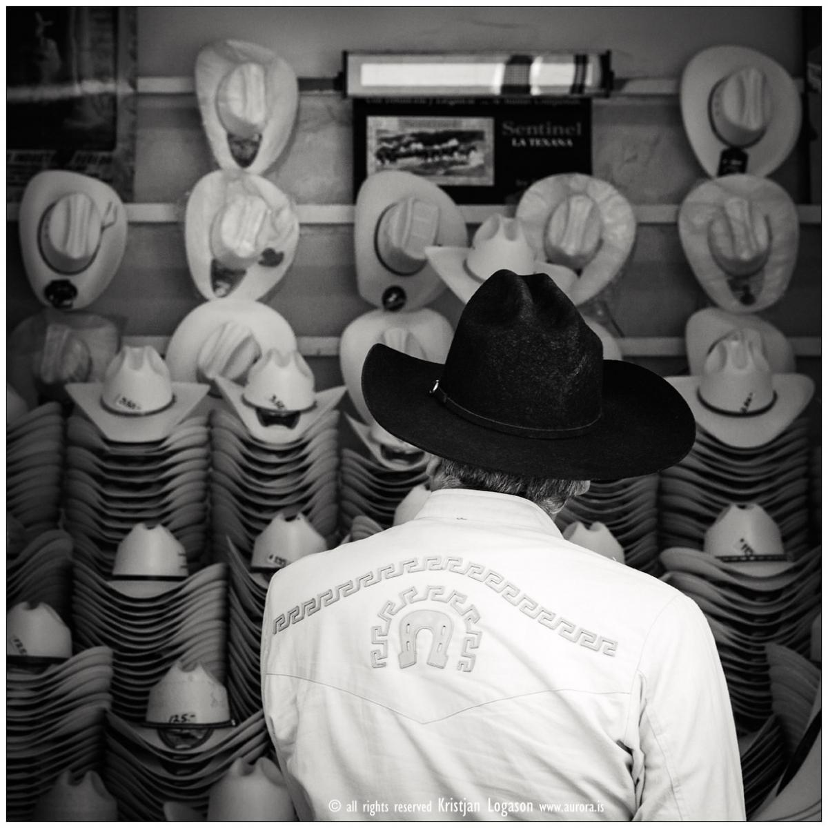 Man choosing hats in San Luis Potosi Mexico