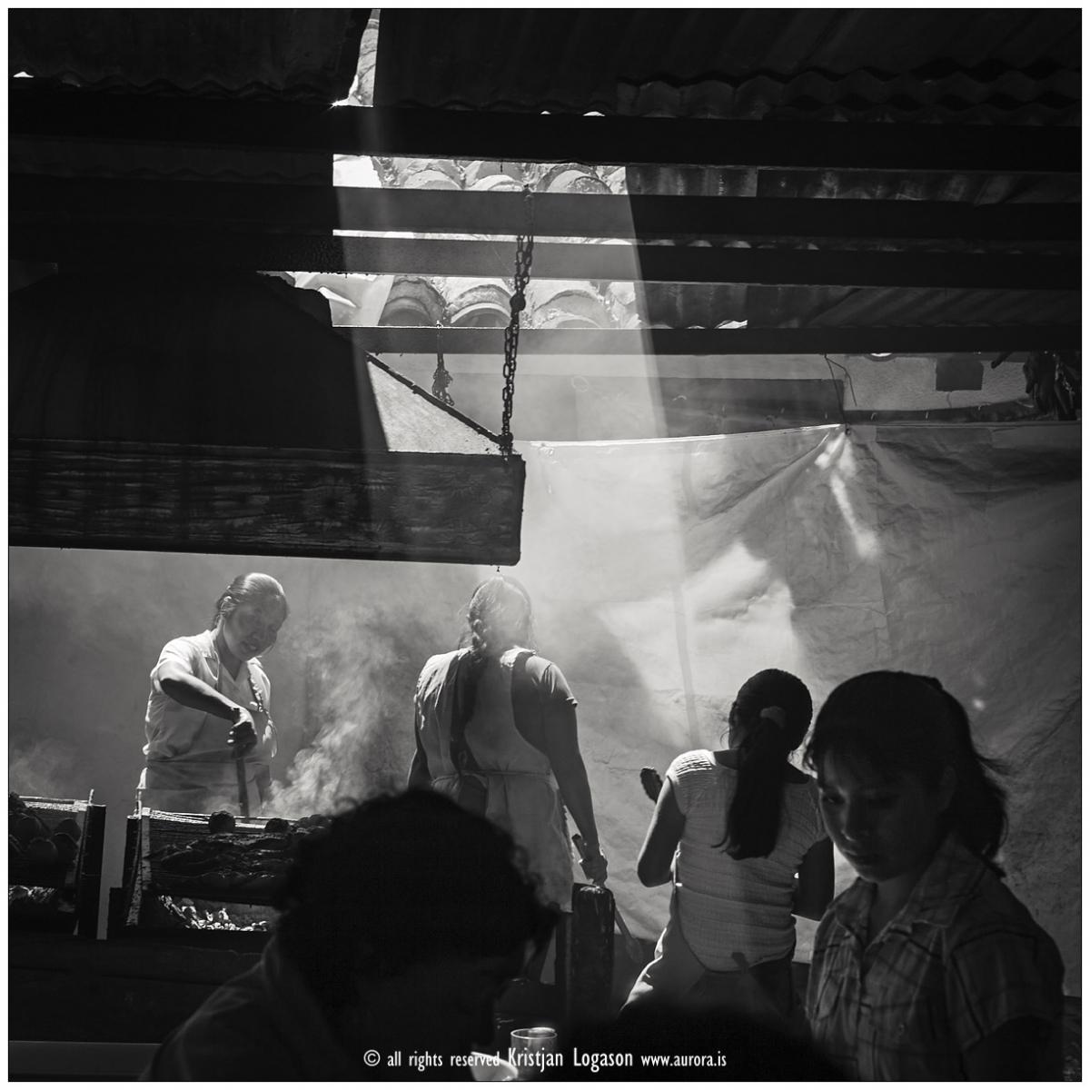 Women working in a smokey restaurant