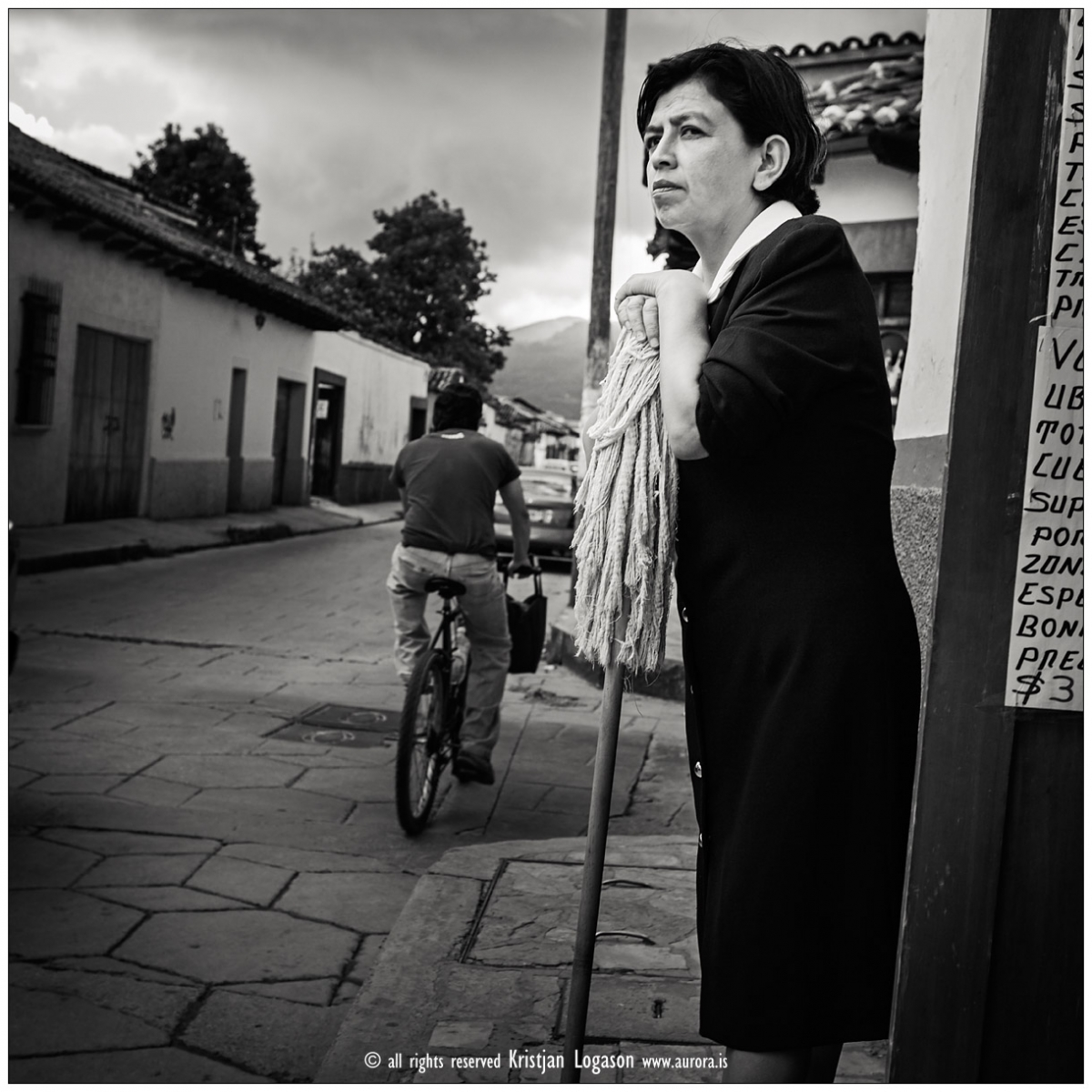 Woman with broom in the street of San Cristobal las Casas