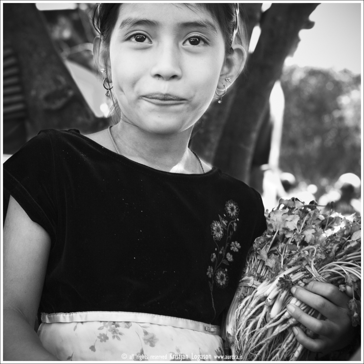 Young girl selling spice at the fiesta gastronomica in Juayua, El Salvador