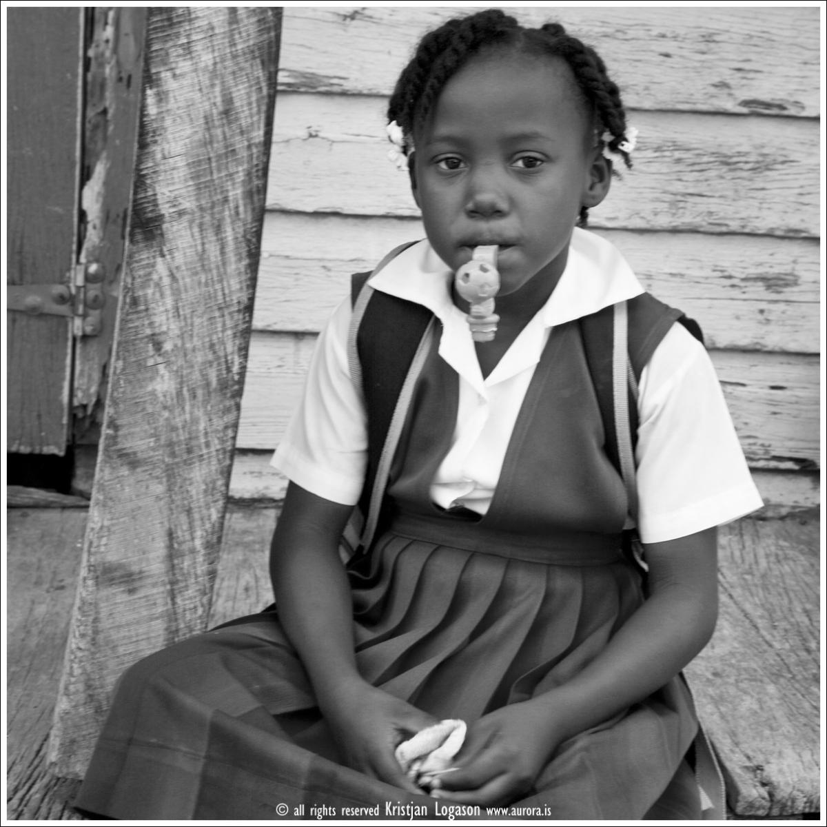 Young school girl with candy in Dangriga Belize