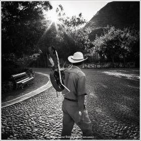 Man walkling in the cobblestone streets of San Javier in Baja California Sur, Mexico