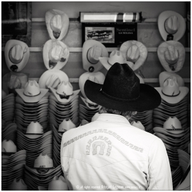 Man choosing hats in San Luis Potosi Mexico