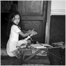 Girl with Doll playing out side here home in Suchitoto in El Salvador